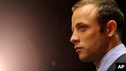 In this Feb. 22, 2013 file photo, Olympic athlete Oscar Pistorius stands in the dock during his bail hearing in Pretoria, South Africa.