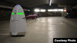 This photo from California manufacturer Knightscope shows the company's K5 security robot keeping tabs on a parking area.