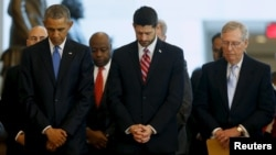 FILE - U.S. President Barack Obama (L-R), House Speaker Paul Ryan (R-WI) and Senate Majority Leader Mitch McConnell (R-KY) bow their heads in prayer at the end of a ceremony commemorating the 150th anniversary of the 13th Amendment, which formally abolished slavery in the aftermath of the U.S. Civil War, at the U.S. Capitol in Washington, Dec. 9, 2015.