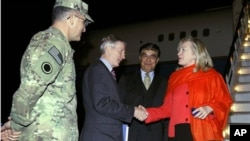 U.S. Secretary of State Hillary Rodham Clinton shakes hands with U.S. Ambassador to Afghanistan Ryan Crocker as Afghan chief of protocol Hamid Saddiq (2nd R) and Lt. General Curtis Scaparotti (left) look on upon Clinton's arrival in Kabul, Afghanistan, We