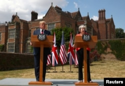 Britain's Prime Minister Theresa May and U.S. President Donald Trump hold a joint news conference at Chequers, the official country residence of the Prime Minister, near Aylesbury, Britain.