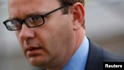 FILE - Former Editor of the News of the World Andy Coulson arrives at the Old Bailey courthouse in central London, June 30, 2014.