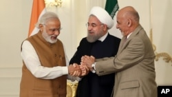 A photo released by the official website of the office of the Iranian Presidency, shows Afghan President Ashraf Ghani (R), Iranian President Hassan Rouhani (C), and Indian Prime Minister Narendra Modi, holding hands in a show of solidarity after their trilateral meeting and signing agreements in Tehran, May 23, 2016.