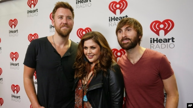 FILE - Lady Antebellum's Charles Kelley, Hillary Scott and Dave Haywood, from left, arrive at the iHeartRadio Country Festival in Austin, Texas, March 29, 2014.