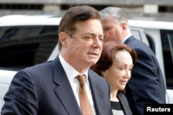 FILE - U.S. President Trump's former campaign chairman Paul Manafort arrives at a hearing at U.S. District Court in Washington.