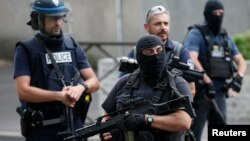 French police and anti-crime brigade (BAC) members secure a street as they carried out a counter-terrorism swoop at different locations in Argenteuil, a suburb north of Paris, France, July 21, 2016.