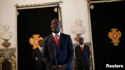 FILE - Guinea-Bissau's President Jose Mario Vaz speaks with journalists.