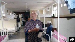 FILE - Said Abdallah lost his left hand in a April 10, 2010 attack.