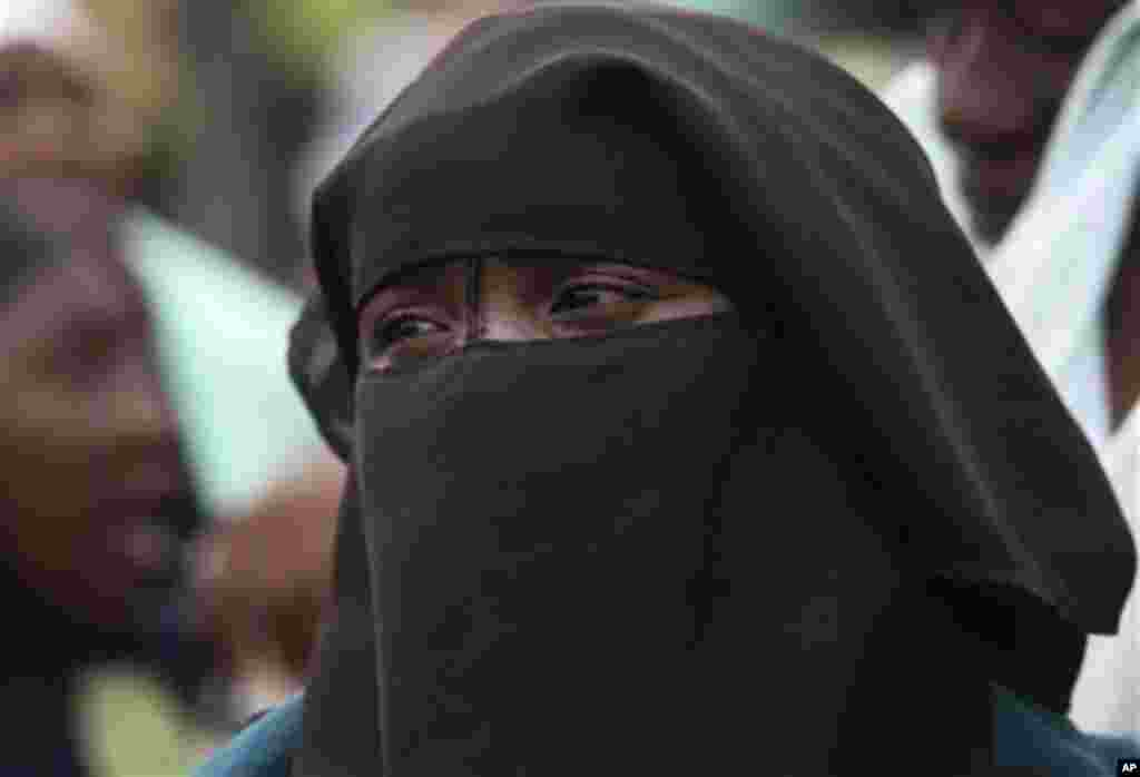 A Muslim woman waits in line to vote during a gubernatorial election in Kaduna, Nigeria, Thursday, April 28, 2011. Two states in Nigeria's Muslim north voted Thursday for state gubernatorial candidates after their polls were delayed by violence that kille