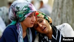 Women mourn in the Turkish city of Gaziantep after a suicide bomber killed more than 50 people at a wedding party on Aug. 21, 2016.