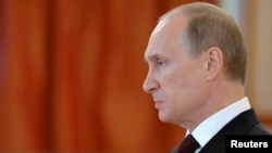 Russia's President Vladimir Putin attends a ceremony of receiving credentials from foreign ambassadors, at the Kremlin in Moscow, June 27, 2014. Putin called on Friday for a long-term ceasefire in Ukraine to allow talks between representatives of Kiev and