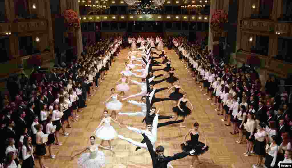 Dancers of the state opera ballet perform during a dress rehearsal for the Opera Ball in Vienna, Austria.