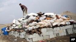 اکتوبر-۲۰۱۴: یوتن شاوخوا شل ټنه مخدره موادو سوزولو ته تیاری نیسي