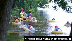 A group of friends enjoy a day of tubing at James River State Park.