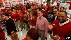 Target CEO Brian Cornell joins store team members before the Thanksgiving opening, Nov. 24, 2016, in Jersey City, N.J.