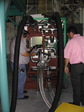 Engineers check the Green Machine, which converts waste heat into electricity, at Southern Methodist University in Dallas. (Courtesy SMU)