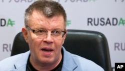 FILE - Nikita Kamaev, managing director of Russian anti-doping agency (RUSADA), talks to reporters at the agency headquarters in Moscow, Nov. 10, 2015.