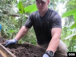 U.S. Marine Sgt. Brandon Rose assigned to Defense POW/MIA Accounting Agency (DPAA), screens soil from a test unit as part of a DPAA investigation mission near Bhismaknagar Village, Arunachal Pradesh, India, Dec. 02, 2016.