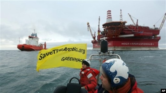 Greenpeace activists near Russian energy giant Gazprom's Arctic oil platform, Prirazlomnaya, in the Pechora Sea, Aug. 24, 2012.
