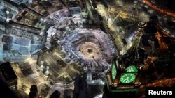 An aerial view shows Muslim worshippers praying at the Grand mosque, the holiest place in Islam, in the holy city of Mecca during Ramadan July 14, 2015, on Lailat al-Qadr, or Night of Power, on which the Koran was revealed to Prophet Mohammad by Allah.