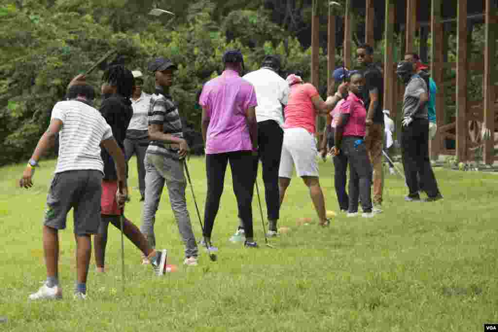 Golf is slowly gaining popularity in Nigeria. Every Saturday, young people take lessons at the IBB International Golf and Country Club in the Nigerian capital of Abuja. Uloma Mbuko is the lead instructor. (Chika Oduah for VOA)