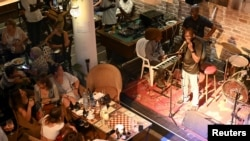 Guitarist Moustapha Diol addresses the audience at the Hotel De La Residence during the Saint Louis Jazz Festival in Saint Louis, Senegal, June 19, 2021. Picture taken June 19 2021. REUTERS/Cooper Inveen