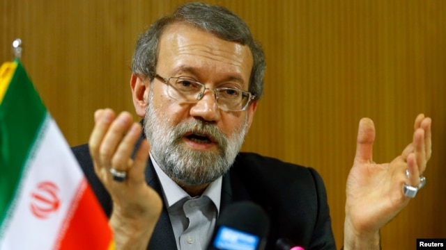 Ali Larijani, Speaker of the Iranian Parliament, gestures during a news conference after the 129th Assembly of the Inter-Parliamentary Union in Geneva, Oct. 9, 2013.