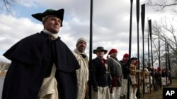 Troops gather during a re-enactment of Gen. George Washington's daring Christmas 1776 crossing of the Delaware River, Monday, Dec. 25, 2017, in Washington Crossing, Pa.