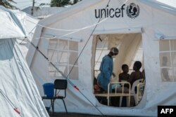 Patients are accommodated in a treatment tent at Macurungo urban health center in Beira, Mozambique, March 27, 2019.
