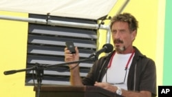 FILE -John McAfee speaks at a ceremony for the official presentation of equipment at the San Pedro Police Station in Ambergris Caye, Belize.