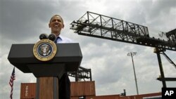President Barack Obama speaks at the Port of Tampa about trade with Latin America before heading to Colombia for the Summit of the Americas, in Tampa, Florida, April 13, 2012.