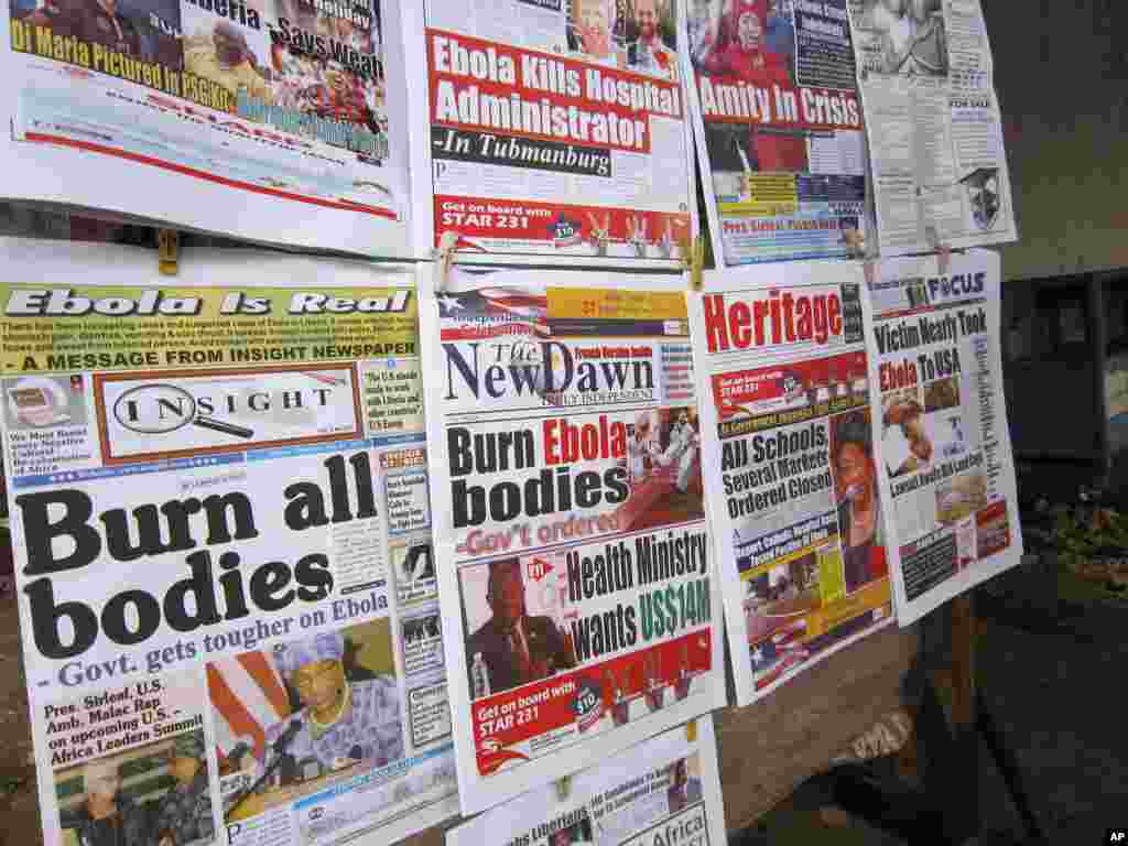 Newspaper headlines prominently display the Ebola outbreak, this headline reads 'Burn all bodies' in the city of Monrovia, Liberia, July 31, 2014.