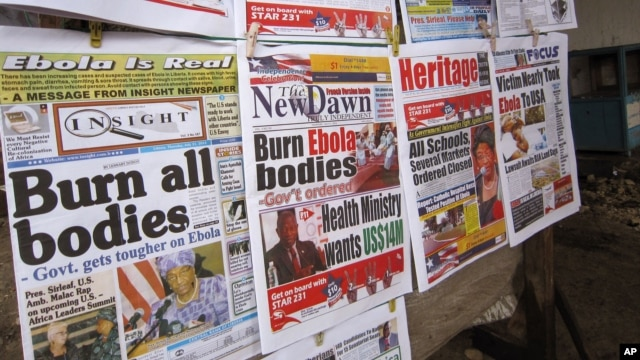 A close up of newspaper front pages focusing on the Ebola outbreak, including a newspaper, left,  reading 'Burn all bodies' in the city of Monrovia, Liberia, Thursday, July 31, 2014. The worst recorded Ebola outbreak in history surpassed 700 deaths in Wes