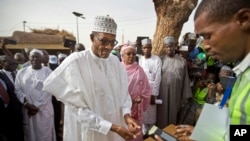 Presidential candidate Muhammadu Buhari prepares to vote in Nigeria's presidential election.