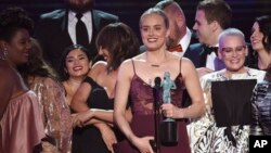 "Taylor Schilling and the cast of ""Orange Is the New Black"" accept the award for outstanding performance by an ensemble in a comedy series at the 23rd annual Screen Actors Guild Awards, Jan. 29, 2017, in Los Angeles. A hacker claims to have stolen the upcoming season of the series."