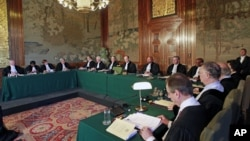 Presiding judge of the Court Peter Tomka (eighth from left) reads the verdict at the International Court of Justice in The Hague, Netherlands, July 20, 2012, ordering the prosecution of former Chadian dictator Hissene Habre.