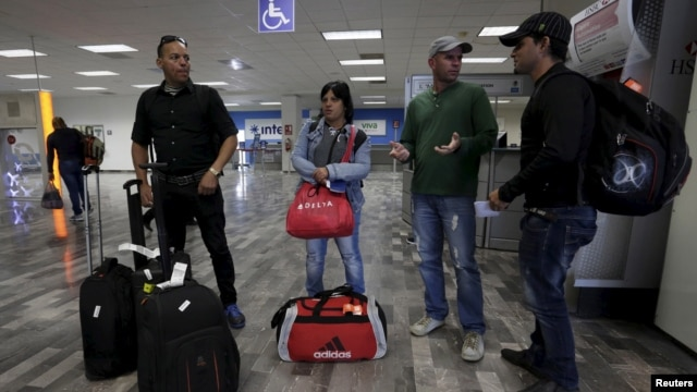 Cuban migrants arrive after traveling en route from Costa Rica to El Salvador, Guatemala and Mexico, before heading to the U.S., at General Lucio Blanco International airport in Reynosa, in Tamaulipas state, Mexico, Jan. 17, 2016.