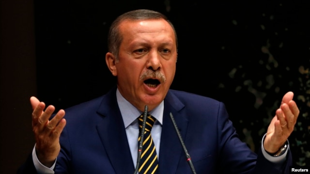Turkey's Prime Minister Recep Tayyip Erdogan addresses members of his ruling AK Party, at its headquarters in Ankara, Dec. 25, 2013.