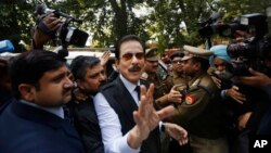 FILE - head of Sahara India conglomerate Subrata Roy speaks to the media as he arrives at the Supreme Court for a hearing in New Delhi, India, Mar. 4, 2014.