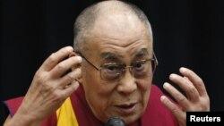 Tibetan spiritual leader the Dalai Lama speaks before members of the Japanese parliament, at the upper house members' office building in Tokyo, November 13, 2012.