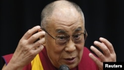 Tibetan spiritual leader the Dalai Lama speaks before members of the Japanese parliament, at the upper house members' office building in Tokyo, November 13, 2012.