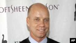 FILE - Former Olympic figure skating gold medalist Scott Hamilton.