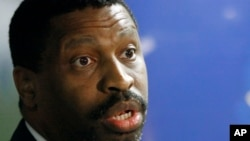 FILE - Derrick Johnson, vice chairman of the NAACP board of directors, will serve as interim president and chief executive officer, officials announced at the 108th national convention in Baltimore, July 22, 2017.
