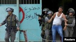 Cảnh sát biên giới Israel bắt giữ một người biểu tình Palestine bị thương trong cuộc đụng độ tại thành phố Bethlehem ở Bờ Tây.