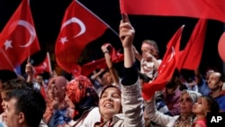 Turkey Military Coup: Supporters of Turkish president Recep Tayyip Erdogan wave Turkish flags during an anti coup rally at Taksim square in central Istanbul, on Sunday, July 31, 2016.