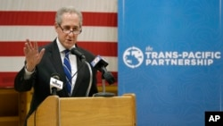 FILE - U.S. Trade Representative Michael Froman speaks during a news conference in Des Moines, Iowa, where a bipartisan group of governors called on Congress to ratify the Trans-Pacific Partnership, July 15, 2016.