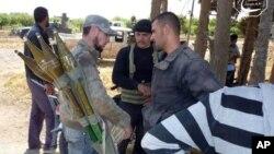 Phe nổi dậy ở Syria chuẩn bị để đẩy lui cuộc tấn công của lực lượng chính phủ ở Qusair, Homs, 19/5/13