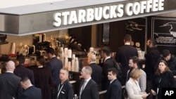 Customers line up at a Starbucks, April 2, 2015 in New York.