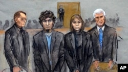 In this courtroom sketch, Dzhokhar Tsarnaev (2nd from Left) is depicted standing with his defense attorneys William Fick (L) Judy Clarke (2nd from R), and David Bruck (R) as the jury presents its verdict in his federal death penalty trial, April 8, 2015,