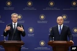 New NATO Secretary General Jens Stoltenberg, left, speaks to the media after talks with Turkey's Foreign Minister Mevlut Cavusoglu, right, in Ankara, Turkey, Oct. 9, 2014.